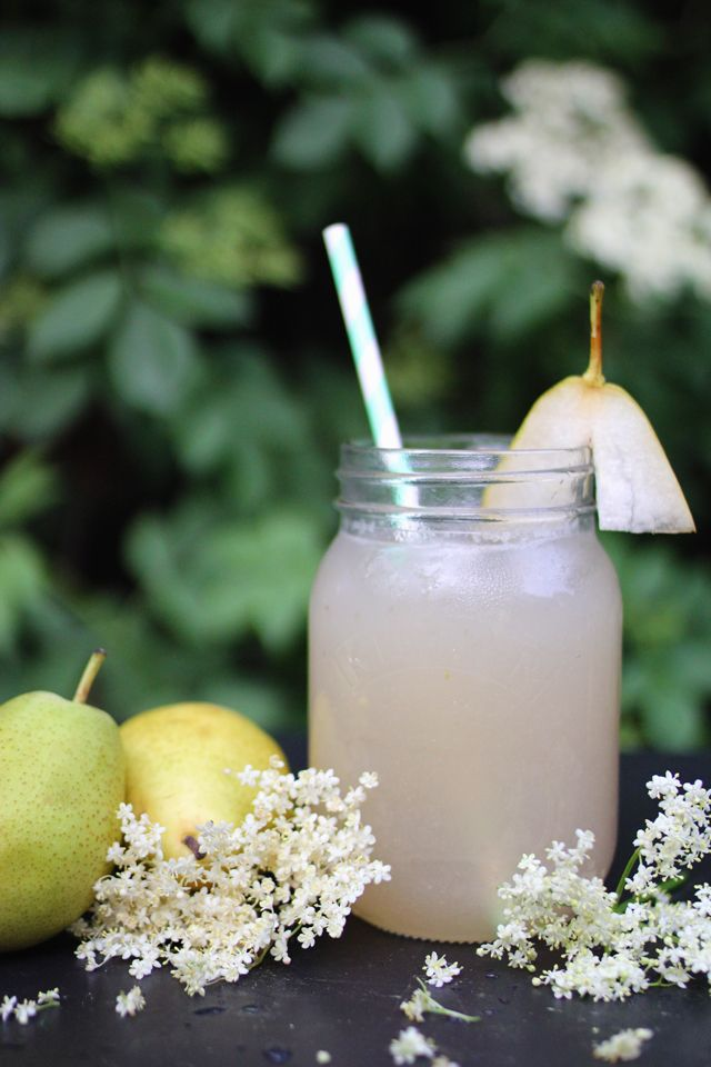 Pear, elderflower, and gin cocktail served in a Mason jar