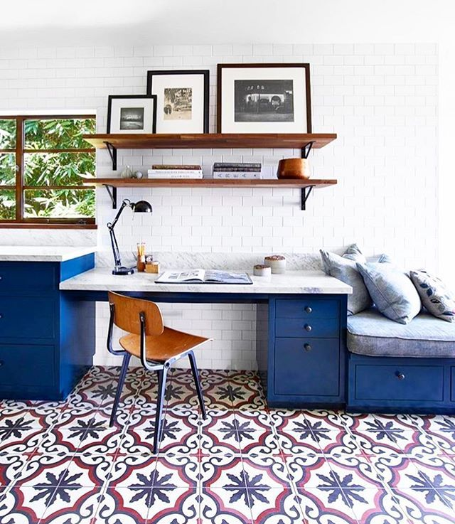 Gorgeous tile and blue cabinets in this office.