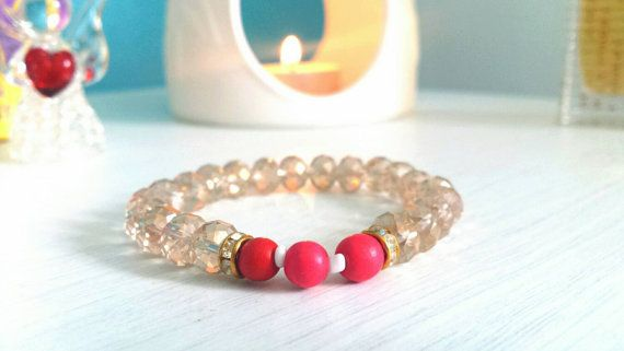 Made with genuine rose quartz and red coral gemstones! Only 1 ever made! Yoga mala spiritual prayer beaded bracelet. View our shop for more info