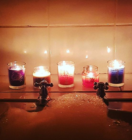 Take a candlelit bath or shower, and listen to some soothing music while you're in there. | 7 Ways To Stress Less This Week