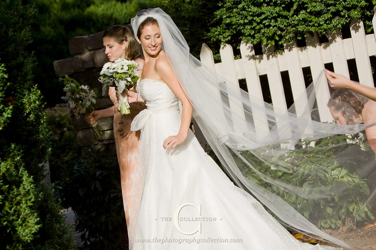 The Collection - Flowing tool wedding dress with a bow around the waist and beautiful vintage long veil  http://www.thephotographycollection.com/