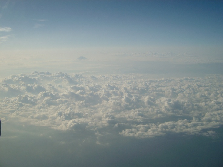 The photograph taken from the inside of the airplane which goes to TOKYO from KUMAMOTO