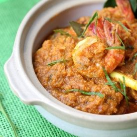Fresh sea prawns cooked in special Malaysian belacan curry paste  garnished with dessicated coconut