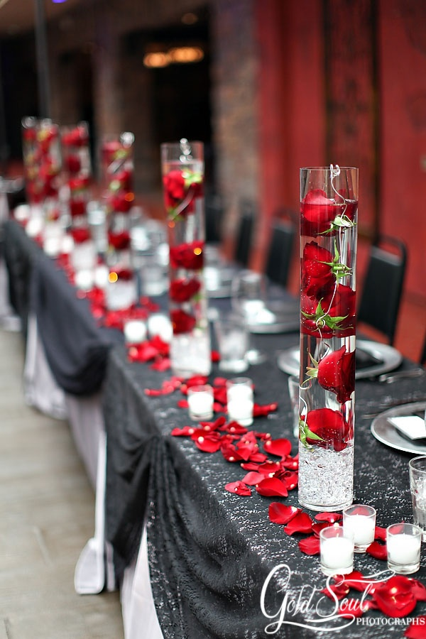 Beautiful rose centerpieces...I'm thinking daisies or orchids instead