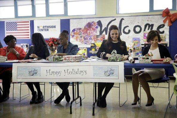 Catherine, Duchess of Cambridge (2R) wraps presents with Chirlane McCray (3L), the wife of the mayor of New York City, during a visit to Northside Center for Child Development on her official two-day visit to the United States on December 8, 2014 in New York City.