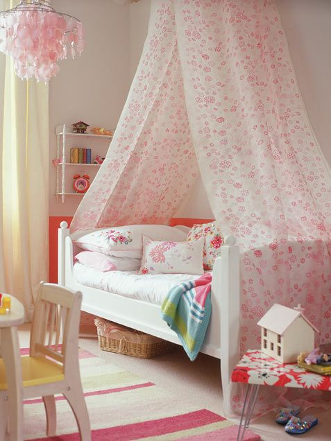 Lovely-White-and-Pink-Girls-Bedroom-Design-with-High-Canopy-Draped-Over-a-Bed