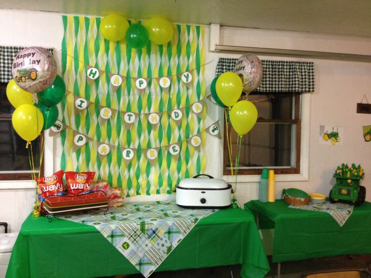 Cut up Burlap sack and baler twine for the personalized happy birthday banner. John Deere fabric on tables $5.99 per yard from Hobby Lobby. Cheap napkins and forks from Walmart $0.99 rolled them up and sealed with small stickers and stuffed them in his John Deere dump truck and placed on the table for display and easy grab access.
