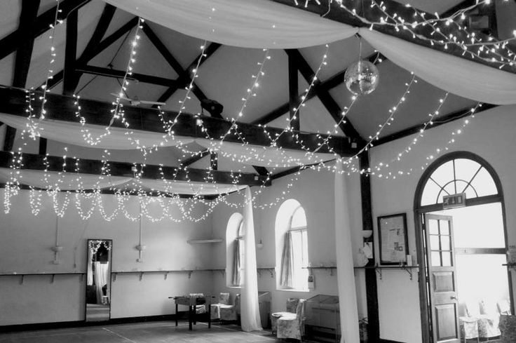 Fairy light ceiling canopy, village hall #wedding #lighting with fabric drops