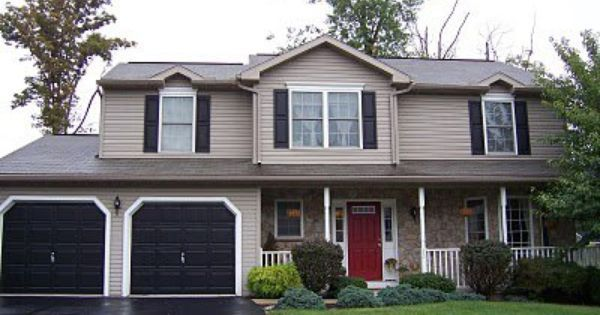 Light grey house with dark grey shutters and dark grey - Front door colors for grey house ...