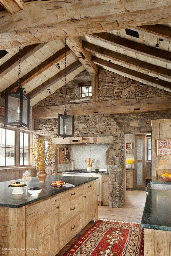 I love the rustic look of a wood and stone kitchen.