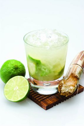 The Caipirinha...My favorite cocktail.  This is how I make it:  1 whole lime cut into eight pieces  Muddle lime with 1 Tbsp. sugar and 1 Tbsp. brown sugar.  Top highball glass with crushed ice.  Pour Leblon Cachaca Rum up close to the rim.  Shake and then enjoy...Ahhhh!  I also add blueberries or strawberries to it for a summery boost.  Fresh ginger in it for a Fall boost.