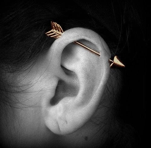 golden Industrial arrow piercings
