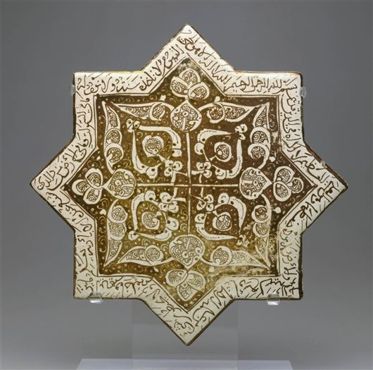 """TILE INSCRIBED WITH THE """"THRONE VERSE"""" FROM THE QUR'AN (Iranian)  Date     1260's Medium     Composite body with opaque white glaze an..."""