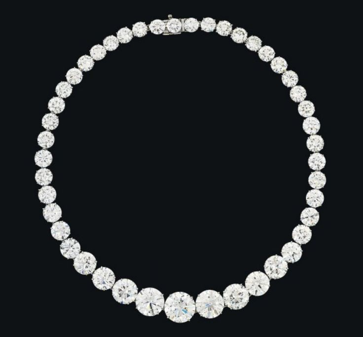 An Important Diamond Riviere Necklace, retailed by Harry Winston (Formerly  the Property of Zsa Zsa Gabor) - Composed of forty-five graduated circular-cut diamonds, the five principal stones weighing approximately 8.07, 6.34, 6.33, 5.35, 4.88 and 4.04 carats, to a concealed clasp, 37.6 cm Unsigned, no. 5512 - Estimate: $1,983,312 - $3,027,160