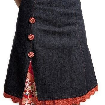 Slight A-line denim skirt with print godet at side seams and ruffle around bottom; fabric covered buttons