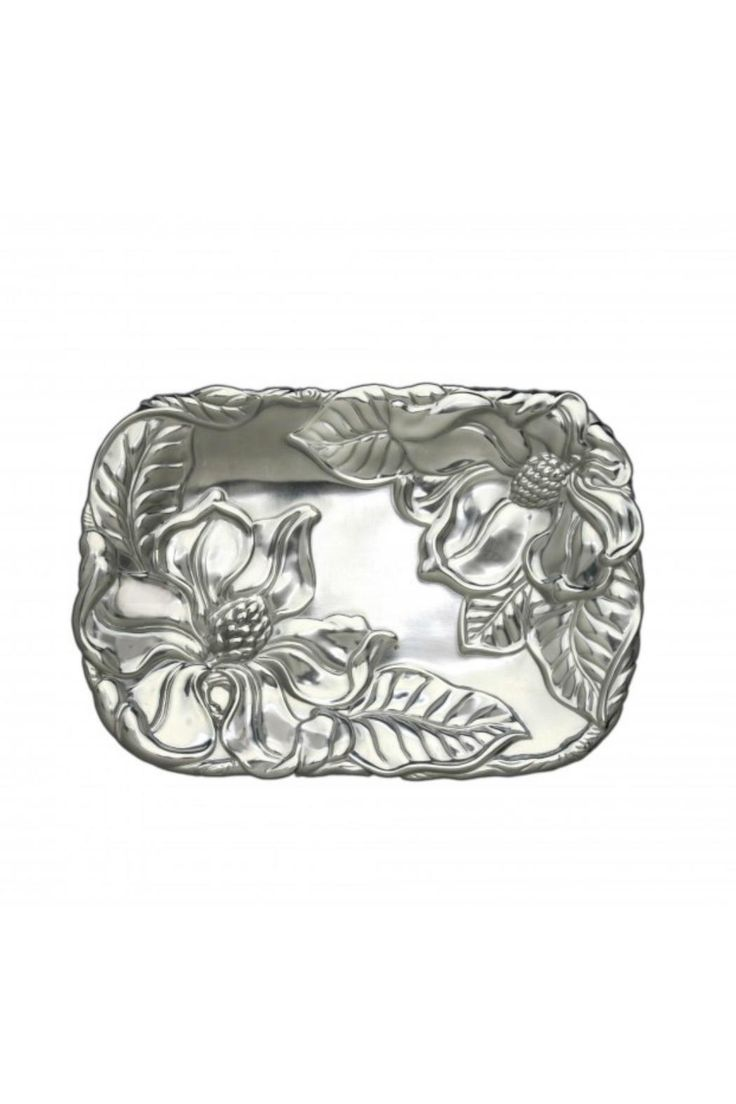"""Exploit the decorative appeal of this beautiful flower by using Arthur Court's Magnolia Catch All. The magnolia's defined carpels and petals mix with heavy lines in the leaves to create breathtaking realism. The unblemished areas of this handmade, aluminum piece gleam against the textured designs.    Dimensions:L: 9.5"""" / W: 7.0""""   Magnolia Catch All  by Arthur Court Designs. Home & Gifts - Home Decor Tennessee"""