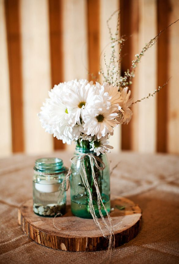 Rustic Country Wedding Table Centerpieces - love the rocks/candle and the flowers in mason jar