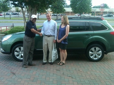 Folger Subaru Sales Consultant Bill Barber with Mr. & Mrs. Wood and their new 2011 Subaru Outback!