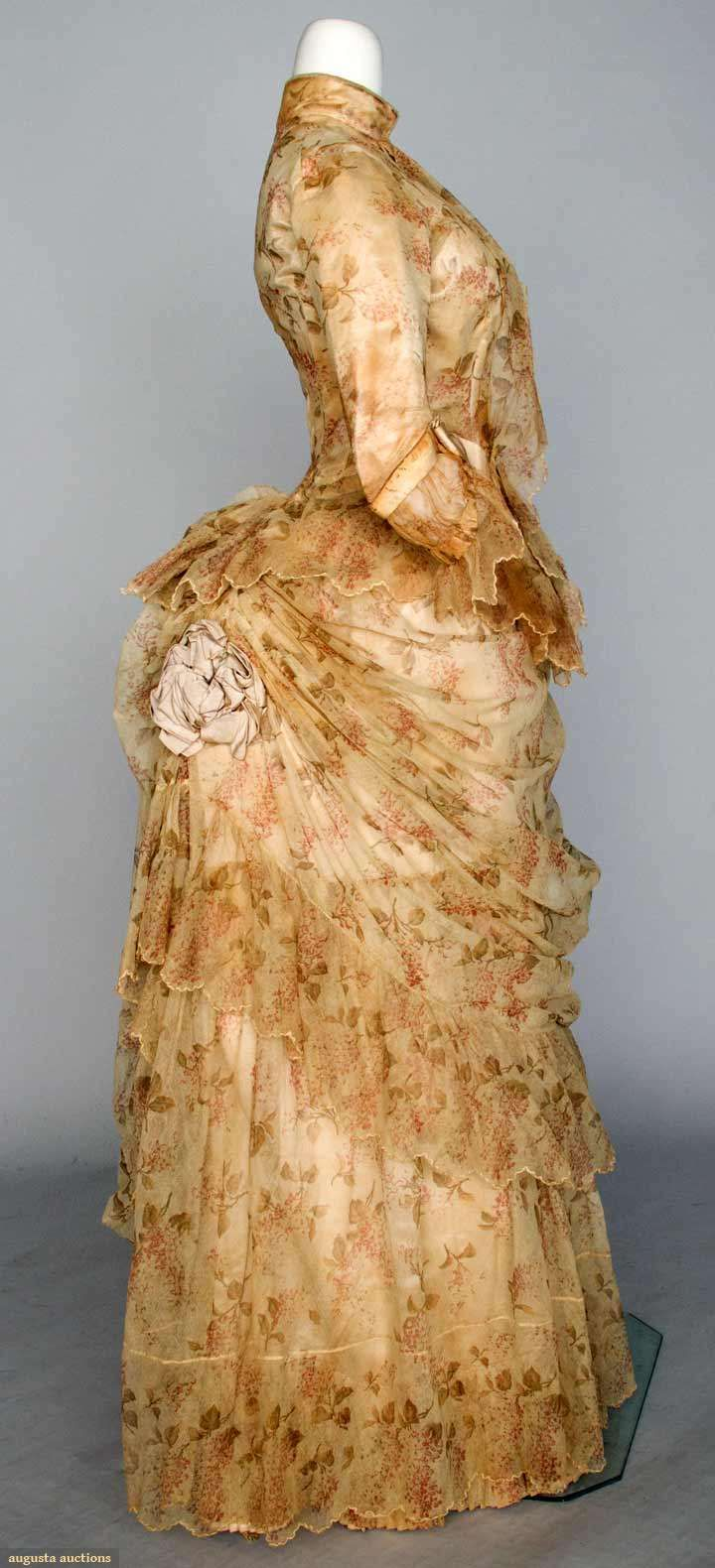 """Printed Tulle Bustle Dress, Two Piece Cream Cotton Tulle Printed With Small Sprays Of Rose Colored Flowers And Green Leaves, A-Symmetrically Draped Skirt With Ribbon Rosettes, Petersham Label """"C. Donovan 216 5th Ave. N.Y.""""  - New York City   c.1886"""