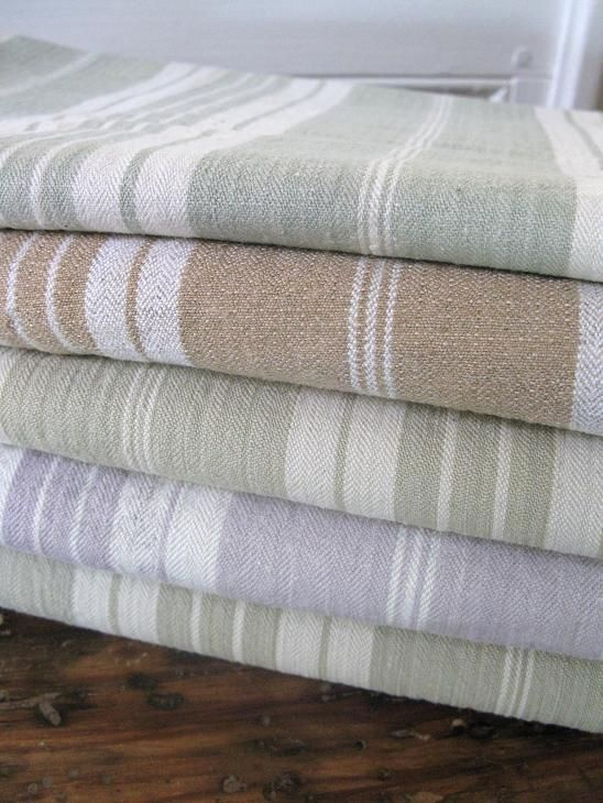 The light green version of the tea towel would fit into the kitchen well with further green accents