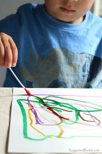 Here's a classic process art project for kids- painting with Q-tips (cotton swabs) and watercolor paint. This art activity is perfect for toddlers, preschoolers, and on up!