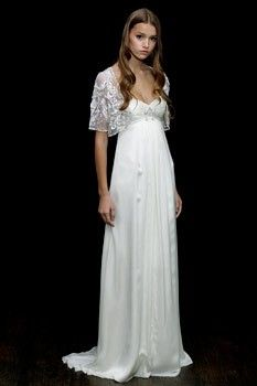 beaded bolero paired with a simple empire waiste gown