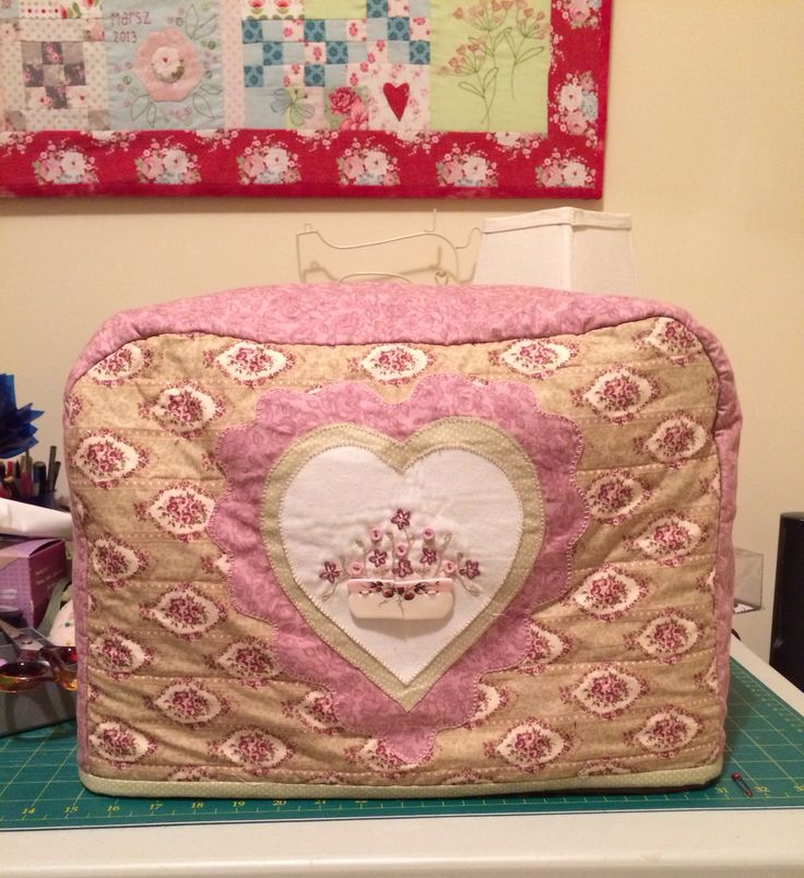 Sewing machine cover with hand sewn details