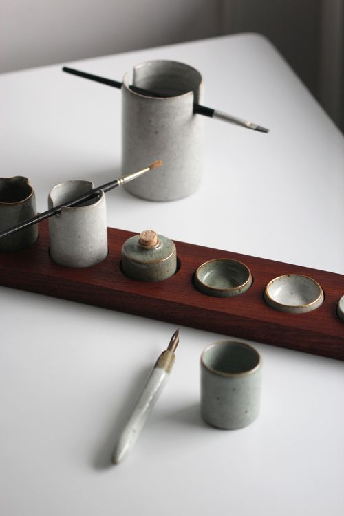 Watercolour palette with a collection of pots with the intent of painting and drawing. Crackle glazes and mahogany. More