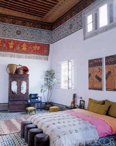 Moroccan wedding blankets + pink & orange in this bedroom of Stephen di Renza's home in Morocco was restored by hand.