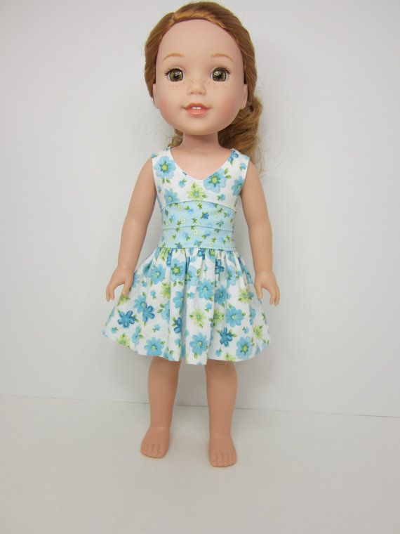 Blue and green floral dress for WellieWishers Dolls by JazzyDollDuds on Etsy. Made from a modified version of the Lisianthus Dress pattern. Find it here http://www.pixiefaire.com/products/lisianthus-dress-18-doll-clothes. #pixiefaire #lisianthusdress