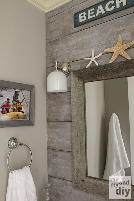 attach faux feet to bottom of cabinet. Add Colorful pictures as art work in this beachy themed bathroom.