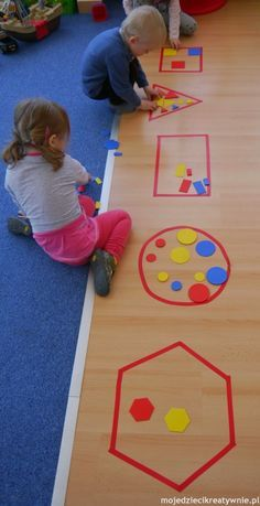 Put a laminated mat with the shape at each table. Place bucket of shapes in middle and have groups sort.