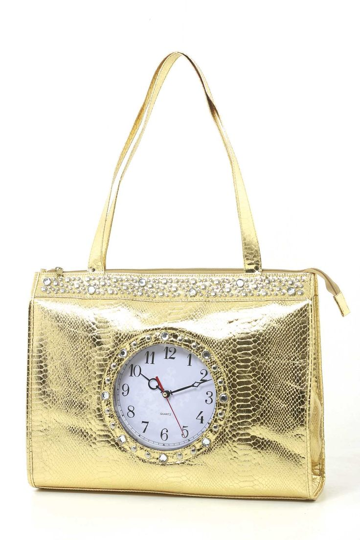 """Novelty Fashion Metallic Gold Tick Tock Clock Shoulder Tote Bag. 16X4X12. This flashy tote bag will definitely make you stand out! It has a working clock on the front with rhinestones surrounding it. The material is made of faux metallic snake skin. The back has an extra pocket for more storage space. The dimensions are 16"""" X 4"""" X 12"""" with a 12"""" shoulder drop. Made in China."""