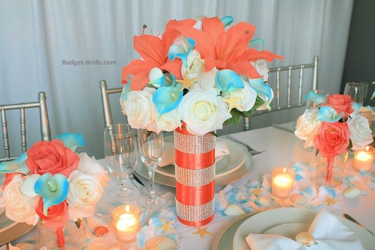 Beach Theme tall wedding centerpieces in coral and aqua