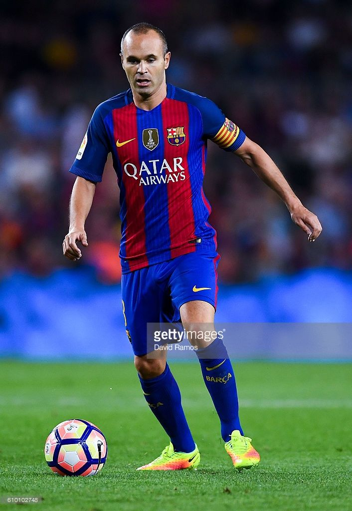 Andres Iniesta of FC Barcelona runs with the ball during the La Liga match between FC Barcelona and Club Atletico de Madrid at the Camp Nou stadium on September 21, 2016 in Barcelona, Spain.