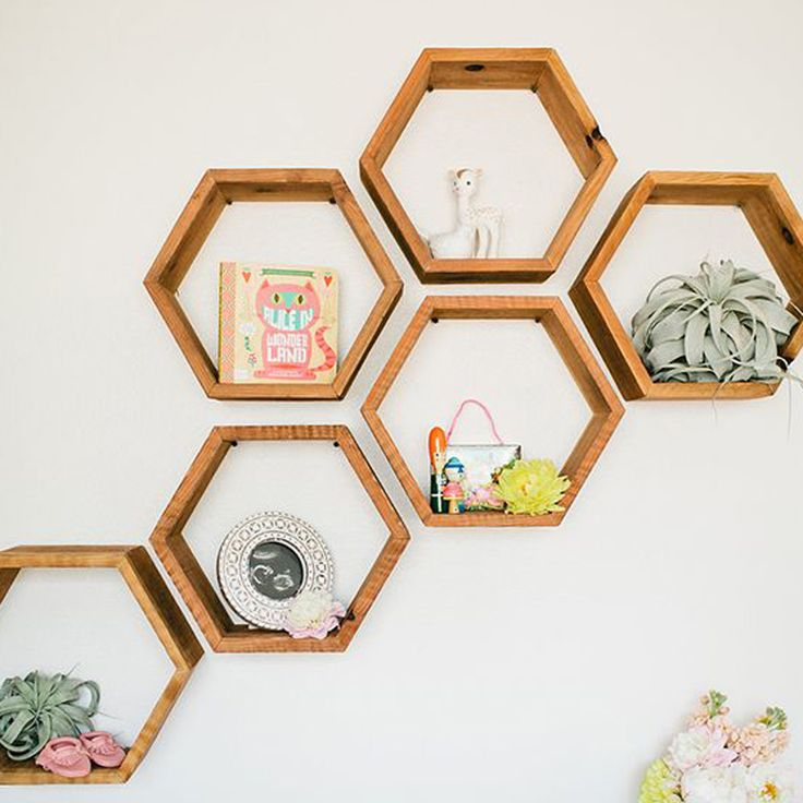 Great arrangement of honeycomb shelves for a striking wall display...#loveKas found on the glitterguide