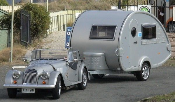 Smart twosome.  Classic car and caravan combination.