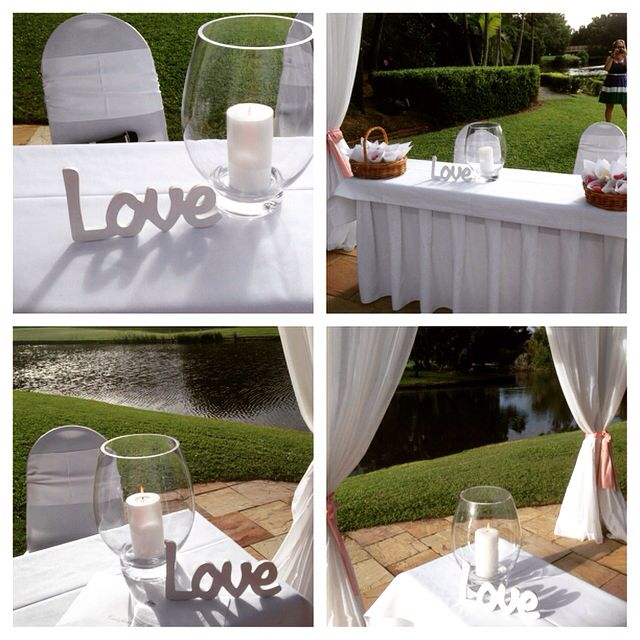 My large glass vase protects your candle for outdoor ceremony
