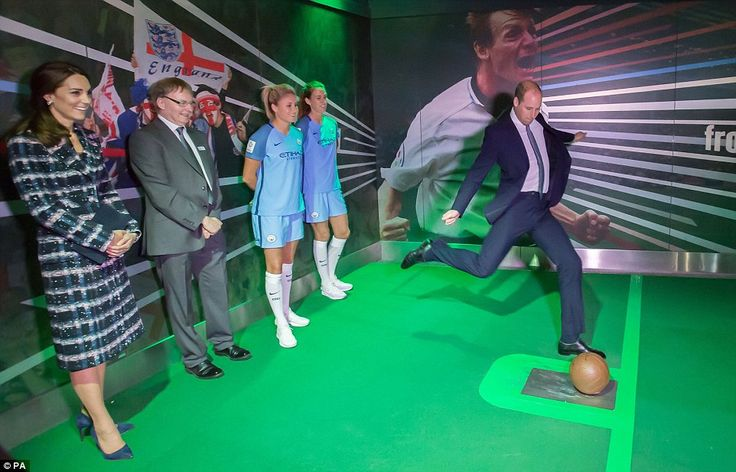 Prince William takes a spot-kick in a computer-generated penalty shoot-out game at the National Football Museum in Manchester
