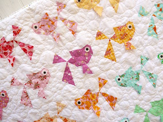 Goldies quilt is a fun traditional paper pieced pattern. Make the project as large or as small as you would like depending on how many goldfish you sew. All the instructions have been written clearly with lots of diagrams of how-tos making the project as easy as possible. templates are at true size and need to be printed on A4 paper. As this is an instant download pattern mailed directly to your download box on receipt of payment, no refunds can be given so please be aware that you are purc...
