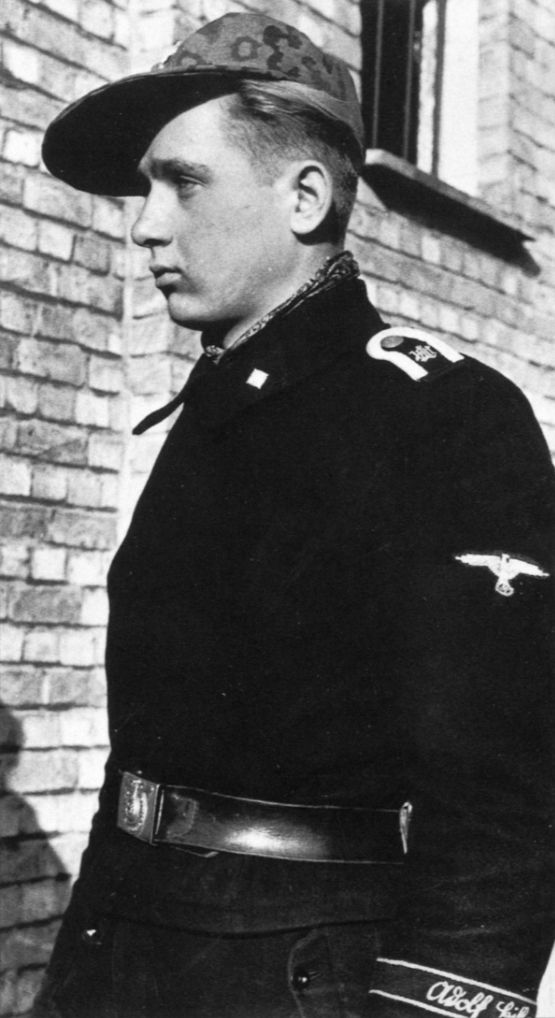"""Portrait of an SS-Unterscharführer from the Leibstandarte Division, spring 1944. His shoulder straps have the embroidered """"LAH"""" cypher, and the machine-embroidered pattern of cuffband is worn."""