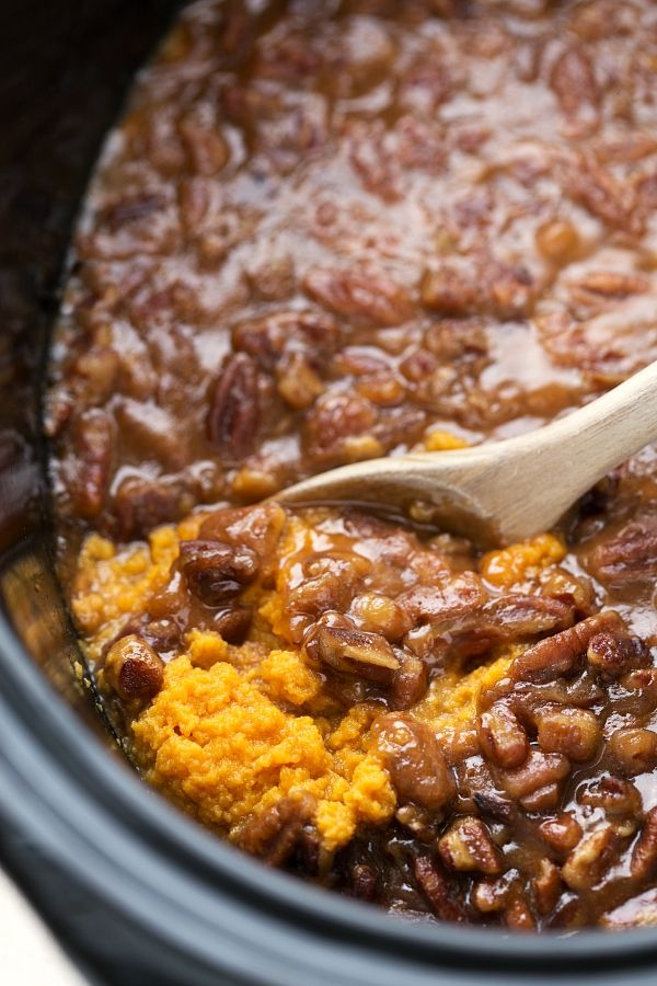 A delicious sweet potato casserole with pecans all made in the slow cooker. One way to save some oven space for Thanksgiving is to use the crockpot! It's time for some Thanksgiving recipes!! The husband, well, he's pretty excited that he's basically getting Thanksgiving for a lot of the month of October/November. He has requested...