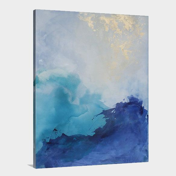 Crashing waves collide below a beautiful, bright sky.This bold abstract  painting pairs perfectly in an coastal inspired space.