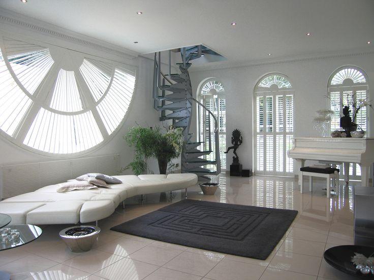 White Shutter Fan by Apollo. Unusual home decor ideas. Unusual shaped shutters. Bespoke shutters. Contemporary home decor shutter inspiration. White colour scheme.