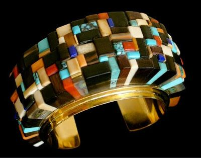 """Pictured here is an extraordinarily large 18K gold """"Height Bracelet,"""" inlaid with over 200 exotic stones and precious woods by Verma (Sonwai) Nequatewa, circa 2005 Verma Nequatewa (Hopi, b. 1949), also known by her professional name (along with her sister) """"Sonwai"""", is Charles Loloma's niece, his former studio apprentice, and the inheritor of his business and artistic legacy after his death in 1991."""