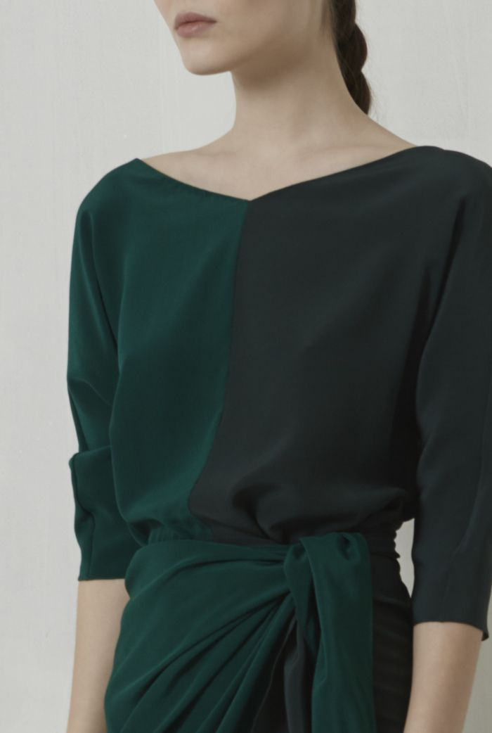 Short two toned silk wrap dress. This design has three quarter length sleeves and and closes by crossing the two parts of the skirt and tying a knot. This dress is available in a combination of green and red.    100% Italian silk.  Crafted in Barcelona.