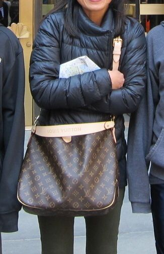 I've posted this somewhere else here on tPF, but here is my Delightful PM  with extra luggage strap to wear her crossbody