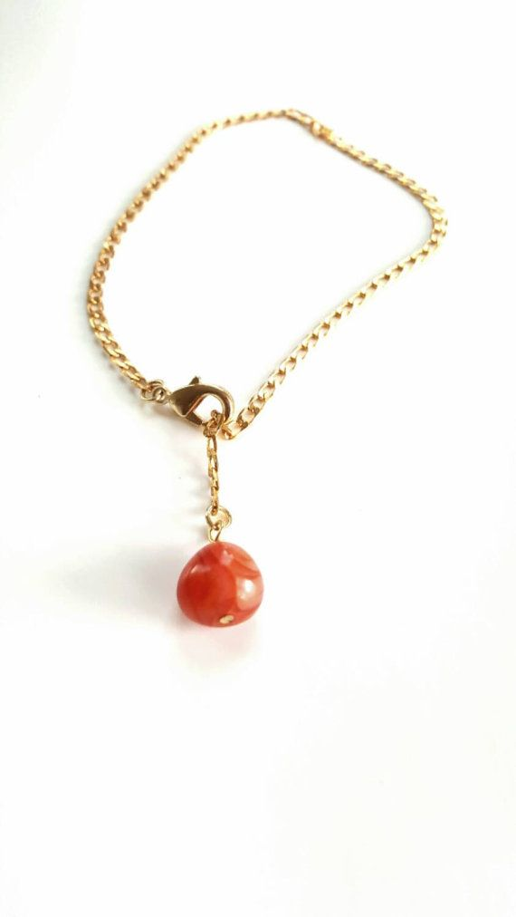 Pairing tumbled carnelian stone with a vintage gold tone chain, this bracelet/anklet became something absolutely stunning. Made to fit the average ankle, this piece turns into a unique pendant bracelet when worn on the wrist. Features a large lobster clasp that easily hooks on to any part of the chain youd like.  Ships immediately in a customized Kraft gift box.