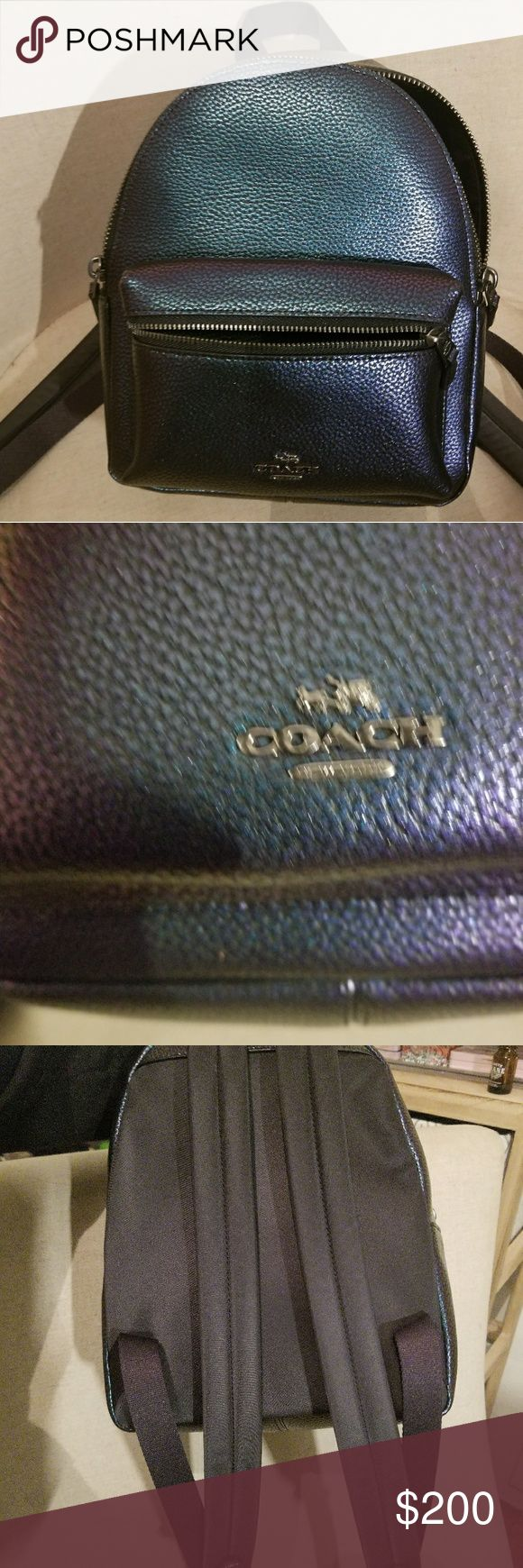 Authentic Coach hologram mini backpack Gorgeous hologram color. Changes between a blue green and purple. Only used once for about an hour. It's basically nwot. It is a Coach mini Charlie backpack with adjustable shoulder straps to fit any size. Coach Bags Mini Bags