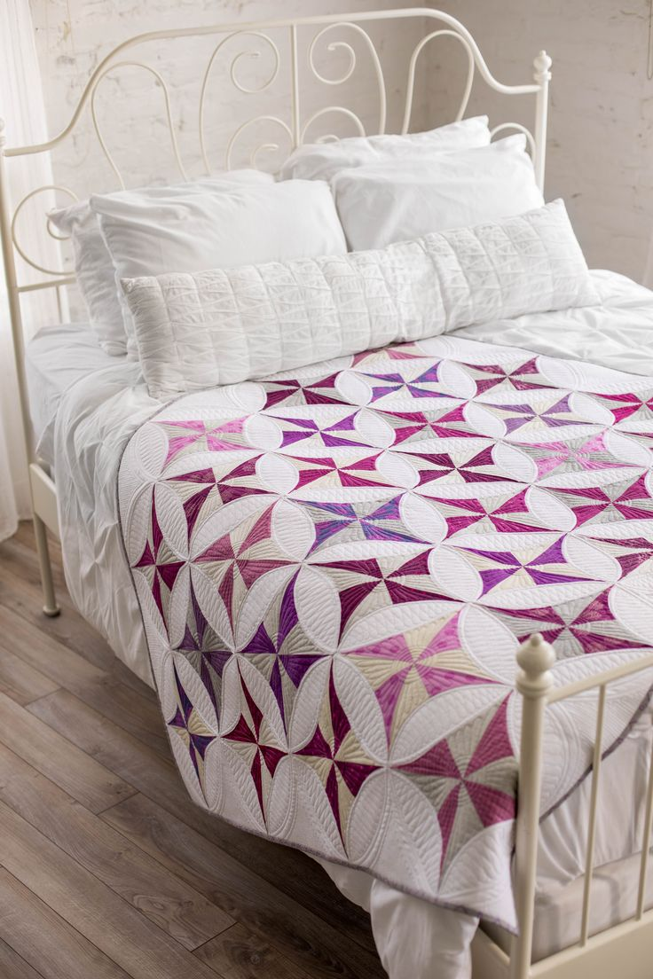 Our Lattice Revival pattern is that perfect mix of modern and traditional! It's pleasing to the eye, fun to make, and is sure to impress! #quiltlove #quilting #quilt #purplequilt #traditionalquilt #modernquilt #quiltphotography #quiltideas #quiltblock #curvedquiltblock #curvedquilt #beautifulquilt #quilt #quilting
